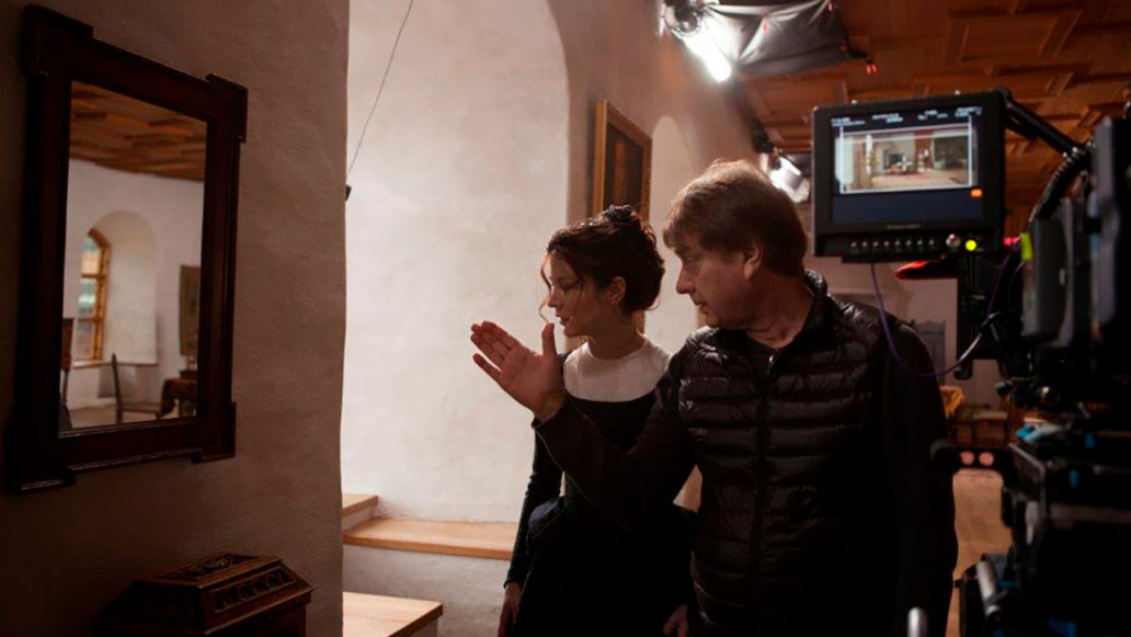 A director guiding an actress in 19th century manor setting.