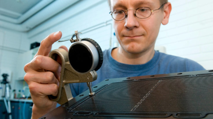 A man inspecting a fuel cell.