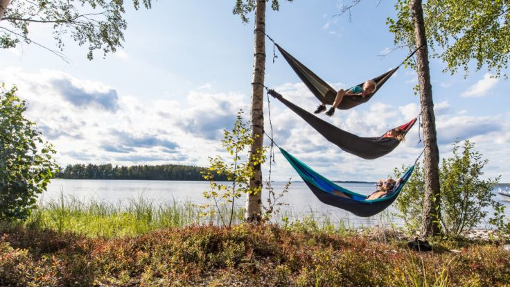 Three hammocks between two trees one on top of each other