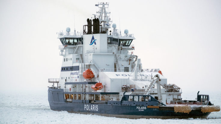 An icebreaker ship over the frozen sea.