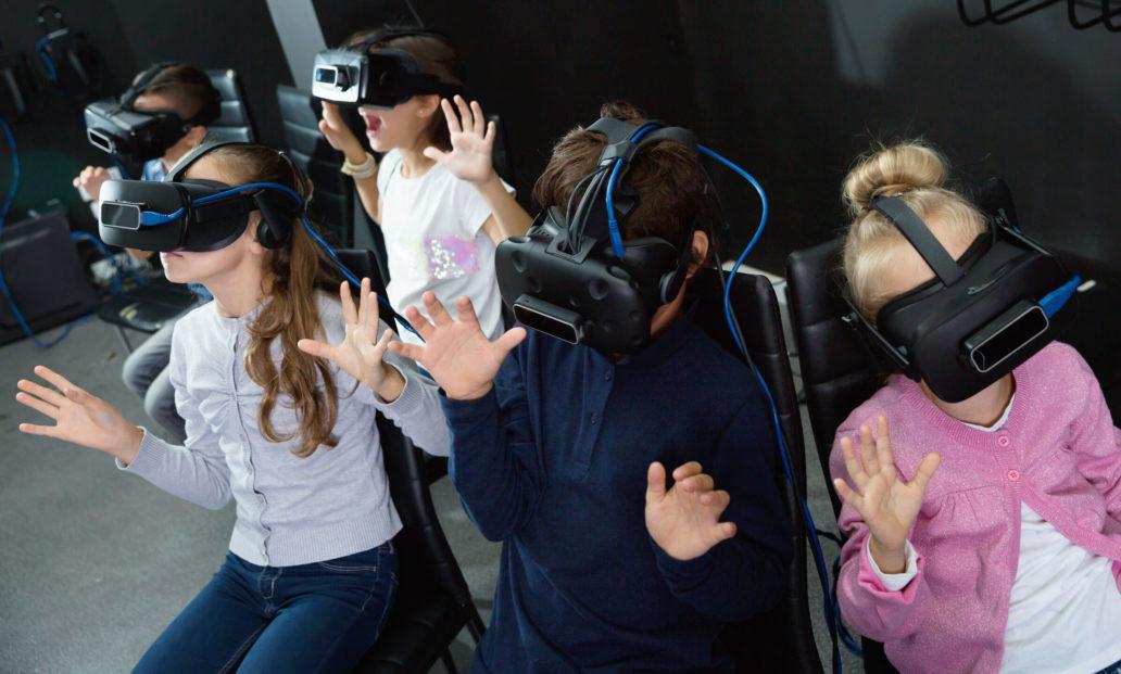 Children wearing virtual reality glasses.