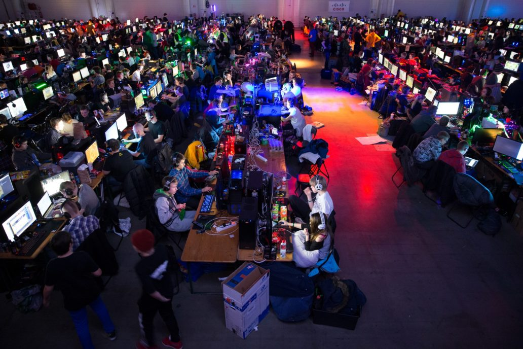 People at an event playing video games.