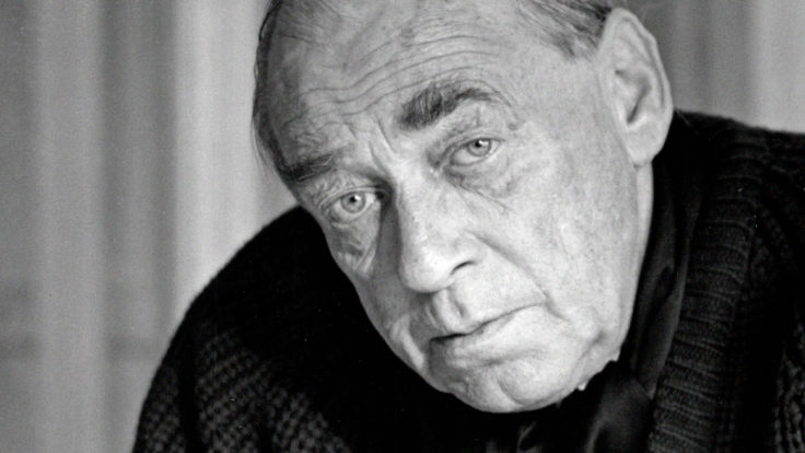 A black and white portrait of a solemn-looking Alvar Aalto.