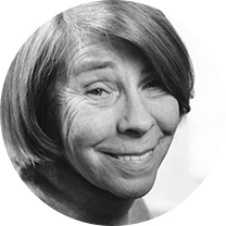 A black and white portrait of a smiling elderly Tove Jansson.