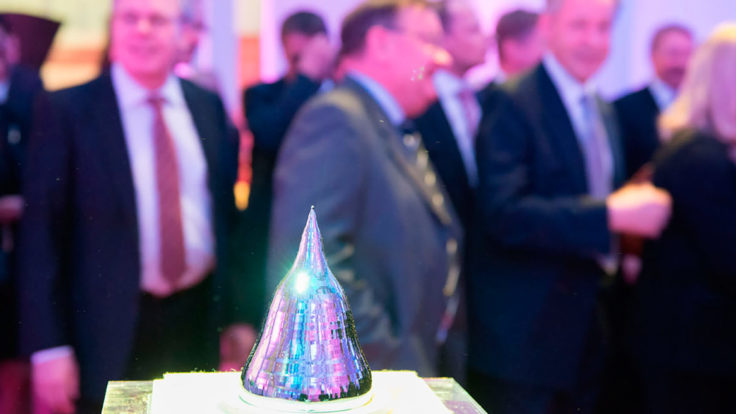 The Millennium Technology Prize with men dressed in suits in the background.