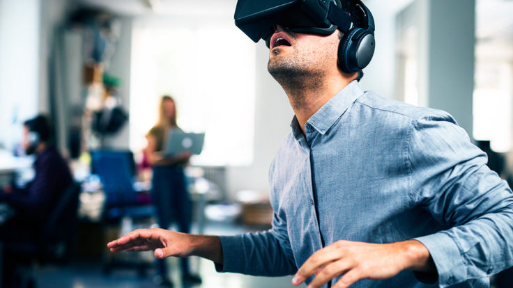 An awed-looking man wearing a VR headset.